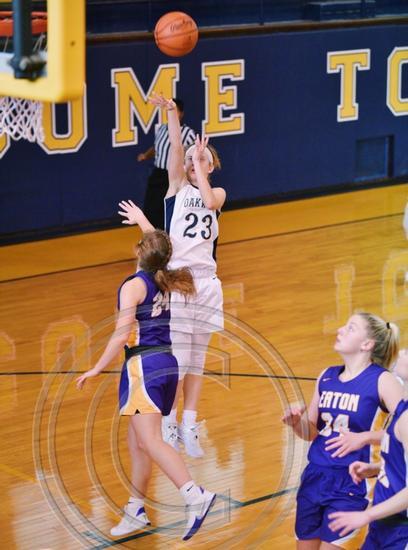 Margie Conrath shooting a basket